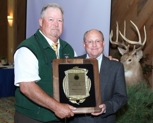 Retired AGLOW Legal Advisor, William Keaton (R) of Rushville, Indiana receives the 2014 Golden Glow Individual Award from AGLOW Past President, Mike Schoonveld. Gary N-ski photo.
