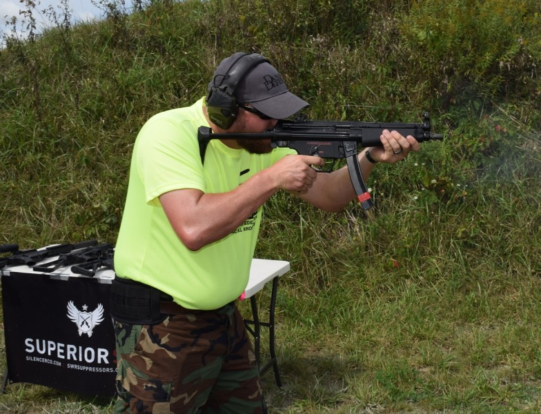 A shooter fires a Dakota Tactical D54P mated with a select-fire trigger mechanism and housing.