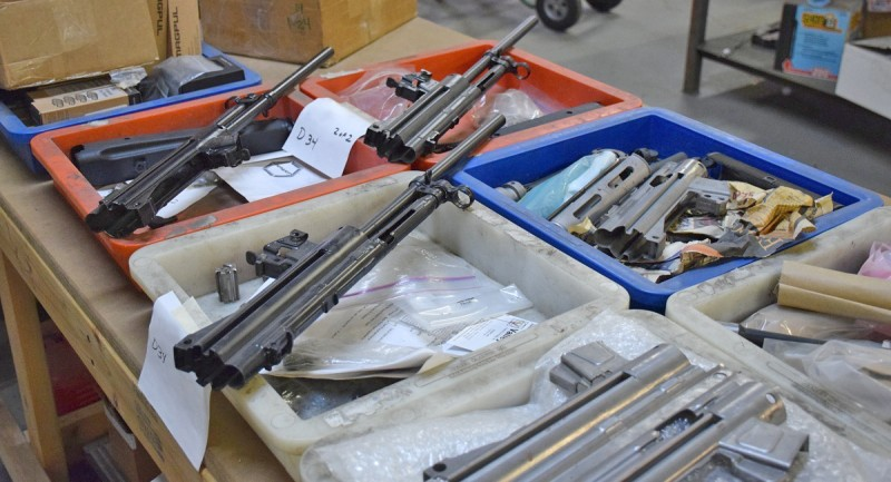 Various parts awaiting assembly into complete firearms at Dakota Tactical's workshop in Canton, Michigan.