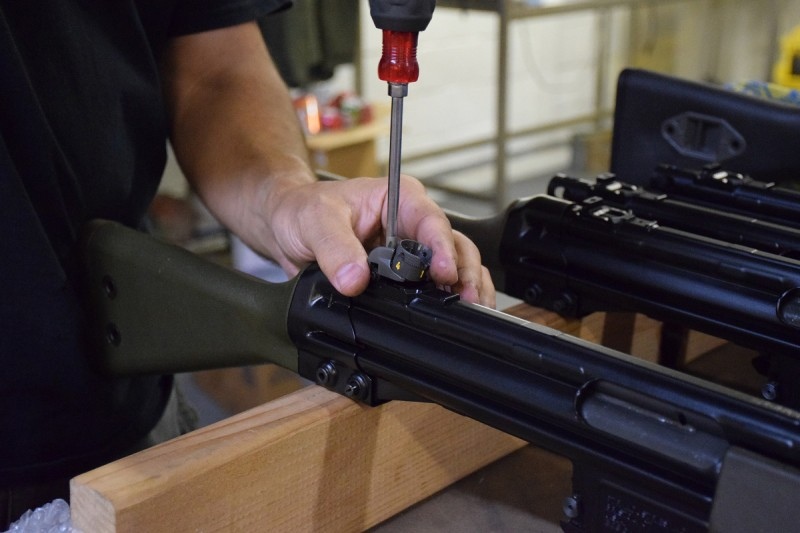 Joe Stoppiello installs a rear sight on a G3-pattern rifle at his shop in Canton, Michigan.