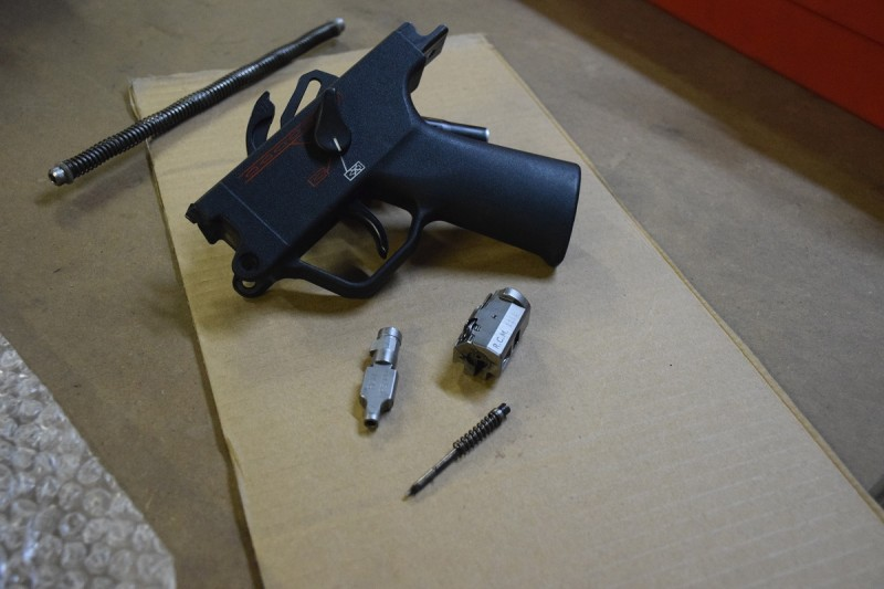 American-made bolt components (foreground) and a select-fire HK trigger mechanism housing.