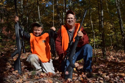 Air rifles, like the one the author's son is holding on the left, are great for kids to learn on. They don't have significant recoil like traditional firearms.