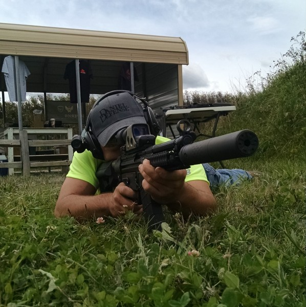Matt Ohrstrom aims the D300P from a prone position.