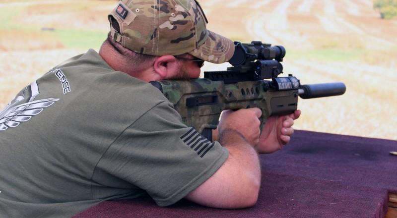 A shooter fires Gear Head Works' 300 BLK Tavor. Image by Edward Osborne.