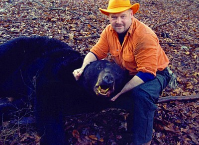 The melon-headed bear in this picture is the largest black bear taken by a hunter. Robert Christian shot it in Monroe County, Pennsylvania in 2011.