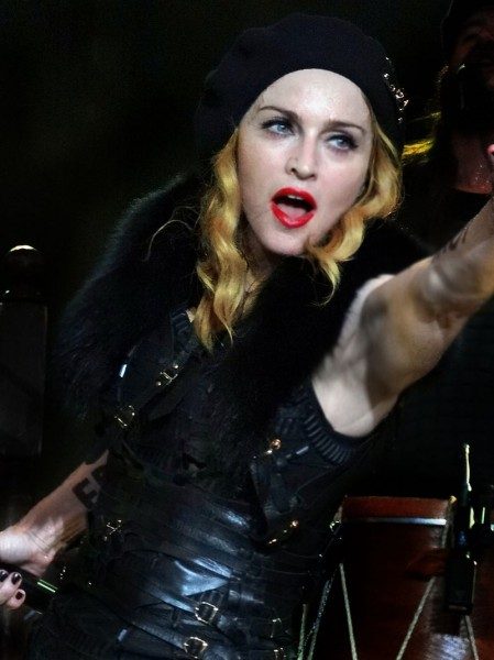 Madonna performing live during the MDNA tour. Image from user IndianBio on the Wikimedia Commons.