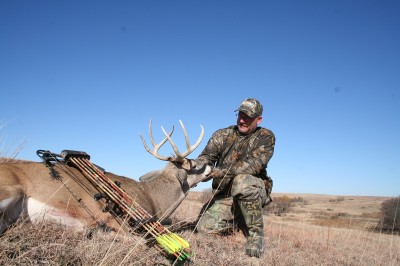 : The author shot this buck on a windy day in Kansas a few years ago. High winds can be used as an excuse to stay home of you can make the most of it.