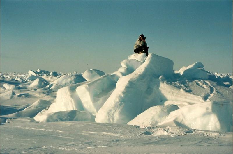 Eric Oogark searching for polar bear while atop an icy terrain feature. Image courtesy Dennis Dunn.