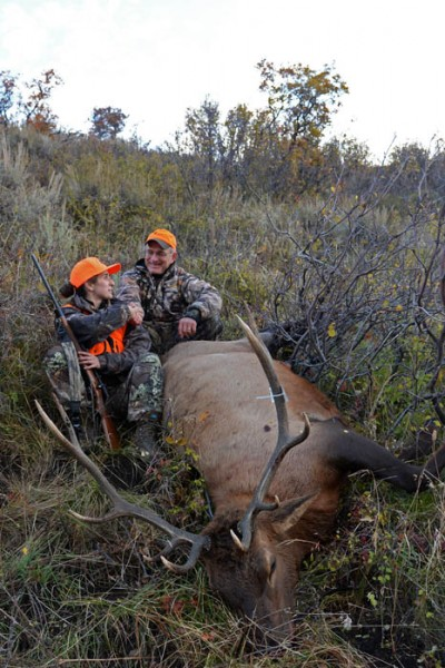Patrick Durkin congratulates his daughter Leah on her first bull elk.