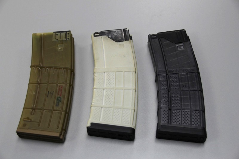 The L5AWM AR-15 magazine, seen here in its final form on the right with developmental models on the left, is one of Lancer's signature products.