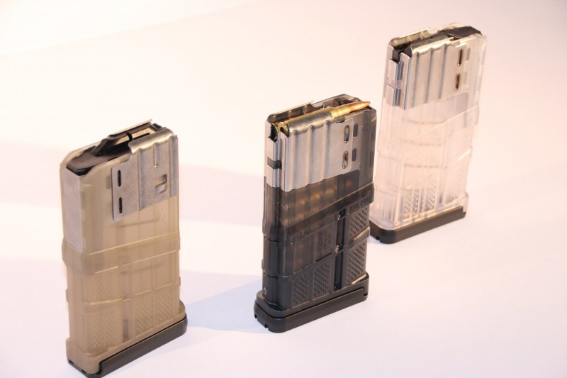 """Three new Lancer L7AWM magazines. The L7s are built around a stainless steel """"core"""" with a polymer body."""