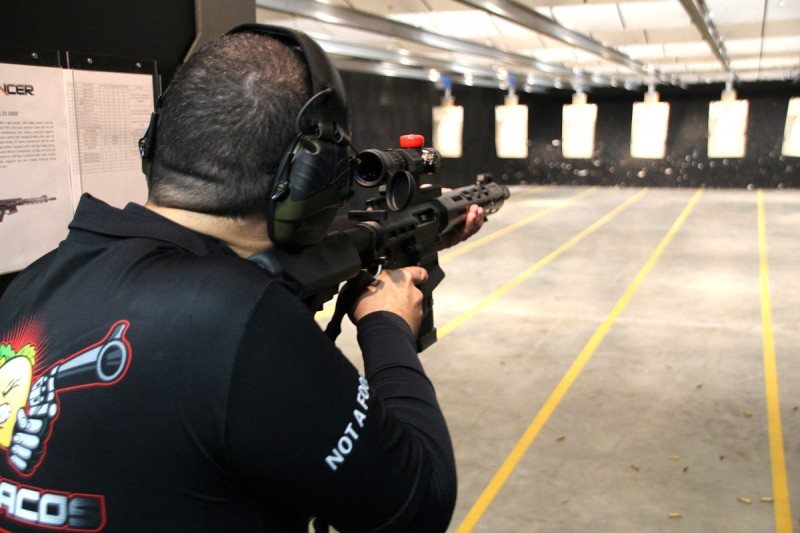 The author shooting a Lancer L30 rifle with the SRSM.