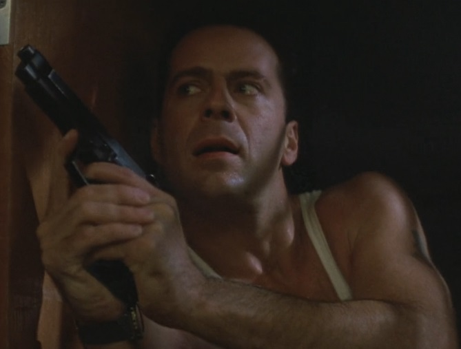 Bruce Willis' character, John McClane, with a Beretta 92F.