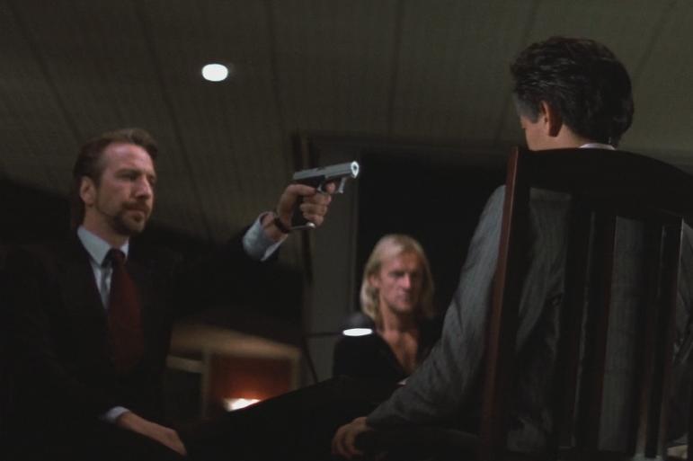 Alan Rickman's character, Hans Gruber, aims his Heckler & Koch P7M13.