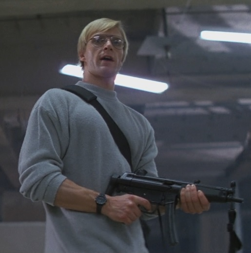 A terrorist armed with a modified HK94 searches for John McClane.