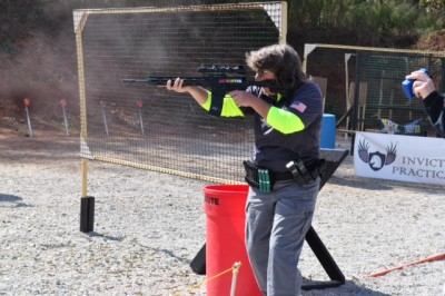 Julie Waasted engages a target with her rifle.