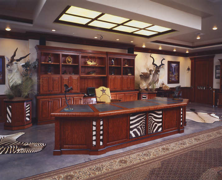 A trophy room can be a workspace, too. Here, a hunter incorporated trophies, desk, and shelves to create a place to conduct business.