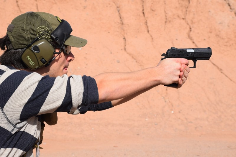 The author shooting a mid-sized polymer Jericho 941 in 9x19mm. Image by Colin Anthony.