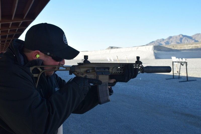 A SIG employee shoots a suppressed, nine-inch-barreled MCX in 300 BLK. Image by Matt Korovesis.