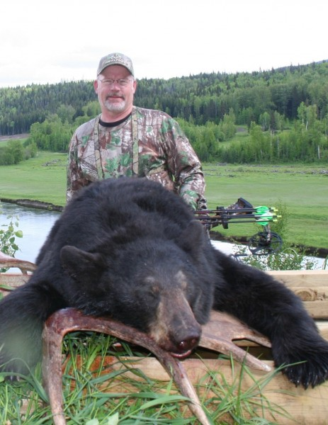 The author has bagged many black bears, such as this one taken in British Columbia in 2013, on the last day of his hunt. He held out for a color phase bear right up until the last minute. Image courtesy Bernie Barringer.