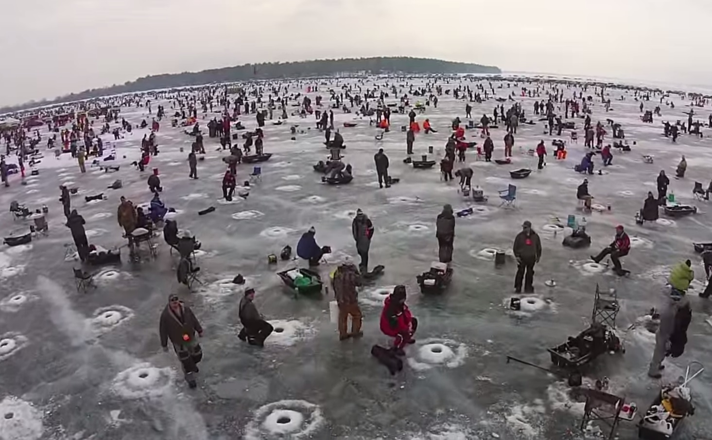 World 39 s largest charity ice fishing contest draws 11 000 for Ice fishing extravaganza