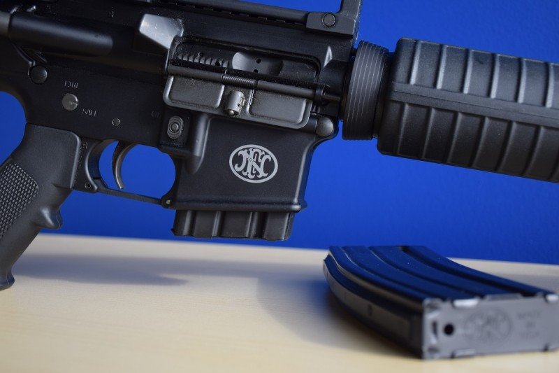 An FN rollmark is prominently displayed on the right side of the FN 15 Rifle's lower receiver.