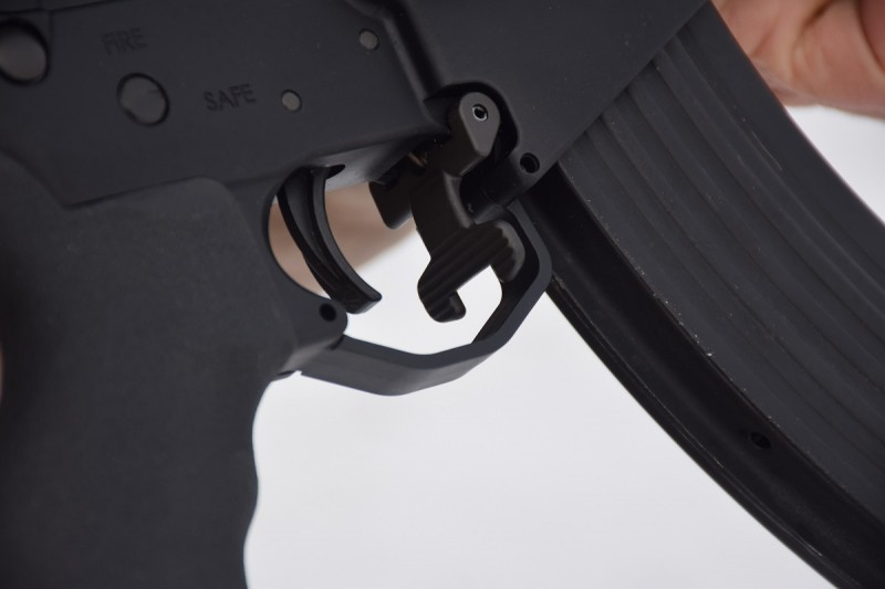 The LAR-47's magazine release is located inside the trigger guard.