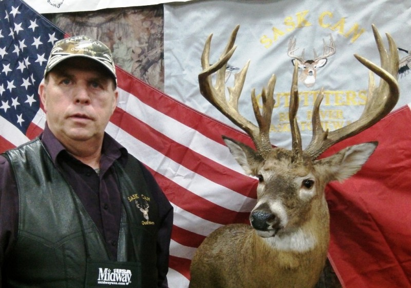 Vern Hyllestad with a Saskatchewan record whitetail by bow taken on one of his hunts.