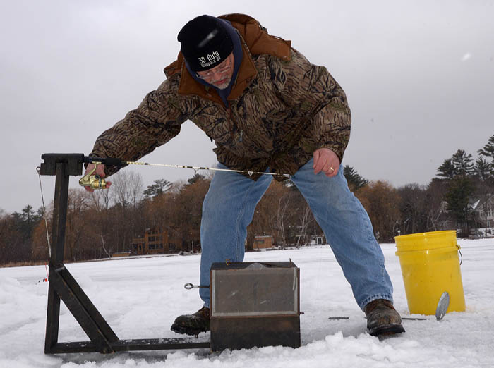 These homemade ice fishing rigs automatically set the hook when a fish strikes.