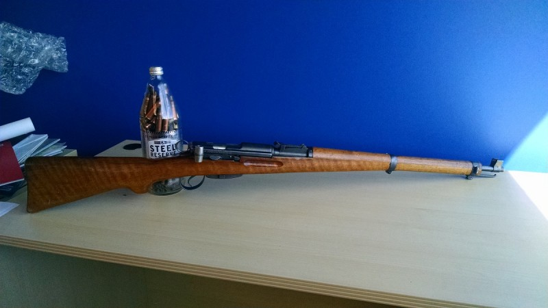 The author's 1934-dated Swiss K31. Typically, custom Steel Reserve paperweights are not included with rifle purchases. Image by Matt Korovesis.