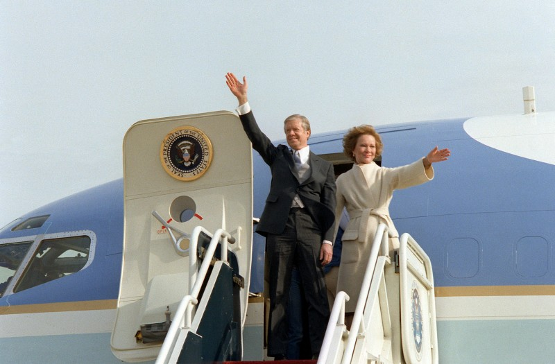 Former_President_and_First_Lady_Carter_wave_from_their_aircraft.jpeg