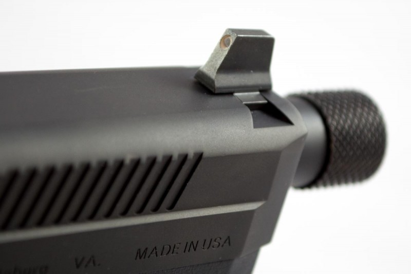 The FNX 45 Tactical comes with tall night sights for suppressor use and a threaded barrel.