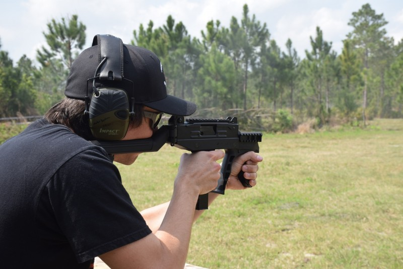 The author shoots the select-fire UZI PRO. Unlike its predecessors, the PRO fires from a closed bolt. Image by Jim Grant.