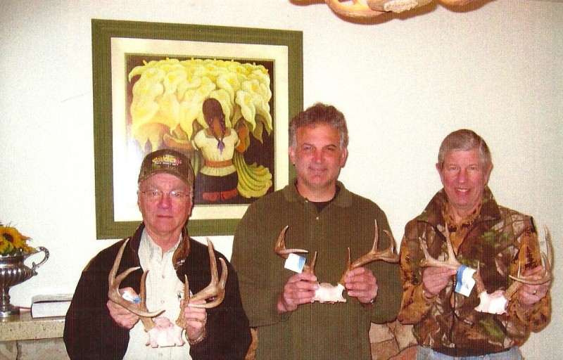 """""""Dr. Dave,"""" Mark, and author with three Pope and Young archery bucks. Image courtesy Dennis Dunn."""