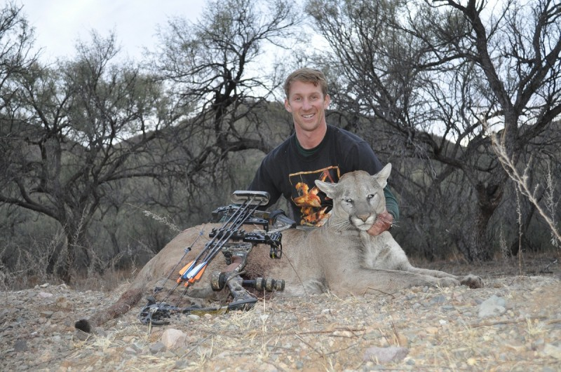 David with his mountain lion. His flechador shirt peeks out from behind the big cat. Image courtesy Dennis Dunn.
