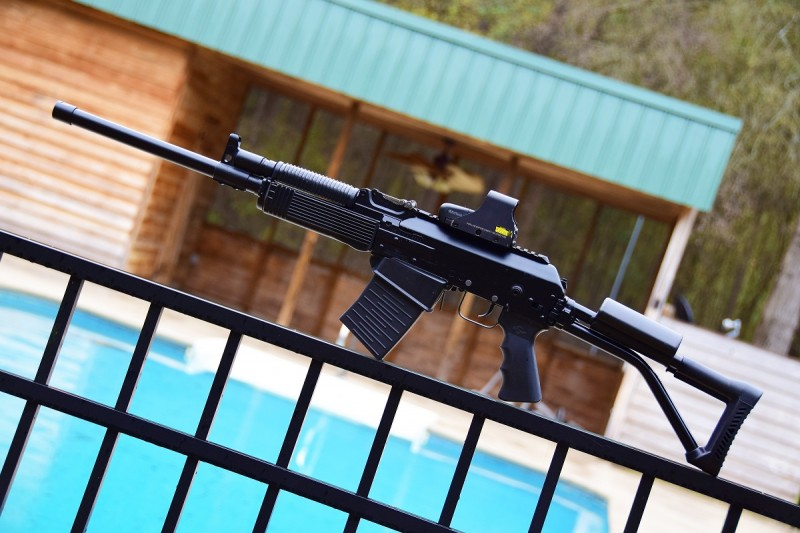The Vepr has conventional AK-style furniture and a top-mounted Picatinny rail.