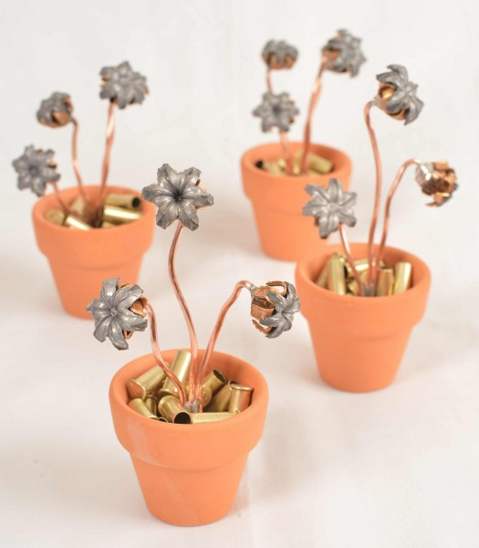 """Completed flowerpots with brass """"dirt."""""""