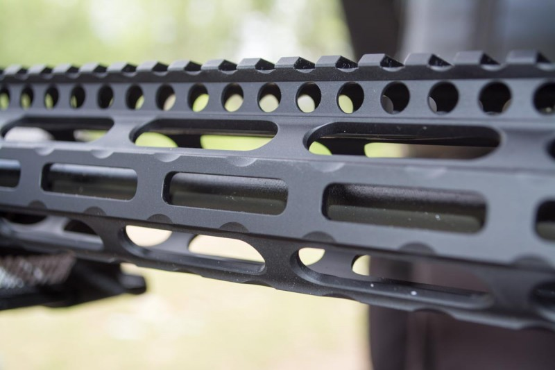 The rounded rectangular holes on the handguard are M-LOK attachment points.