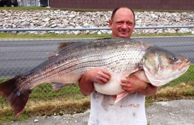 Lawrence Dillman holds up a fish big enough to wrestle with.