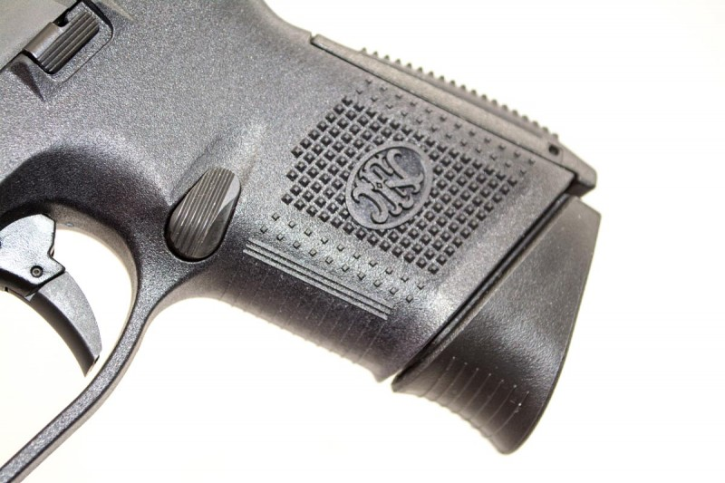 The sides and rear of the grip are moderately textured, while the front surface is covered with light horizontal ridges.