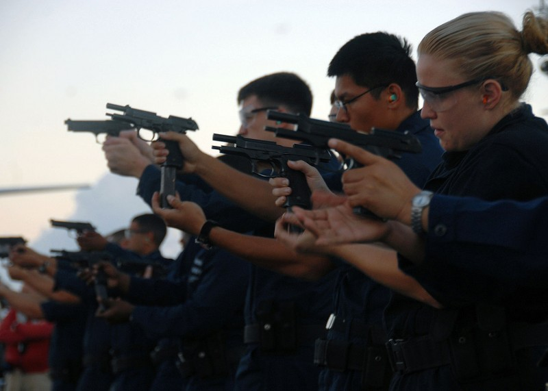 US Navy sailors practicing with the M9.