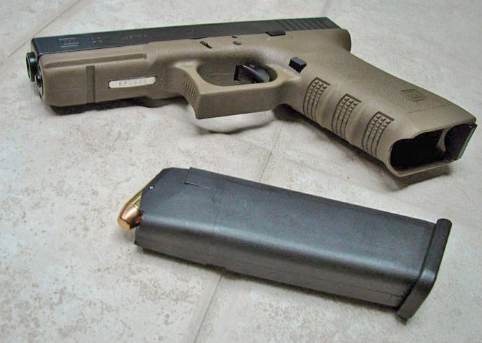 Glock 22 in Olive Drab. Image from Francis Flinch on the Wikimedia Commons.