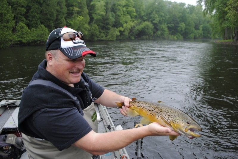 Denny Bouwens shows off a nice brown trout, taken on a Rapala.