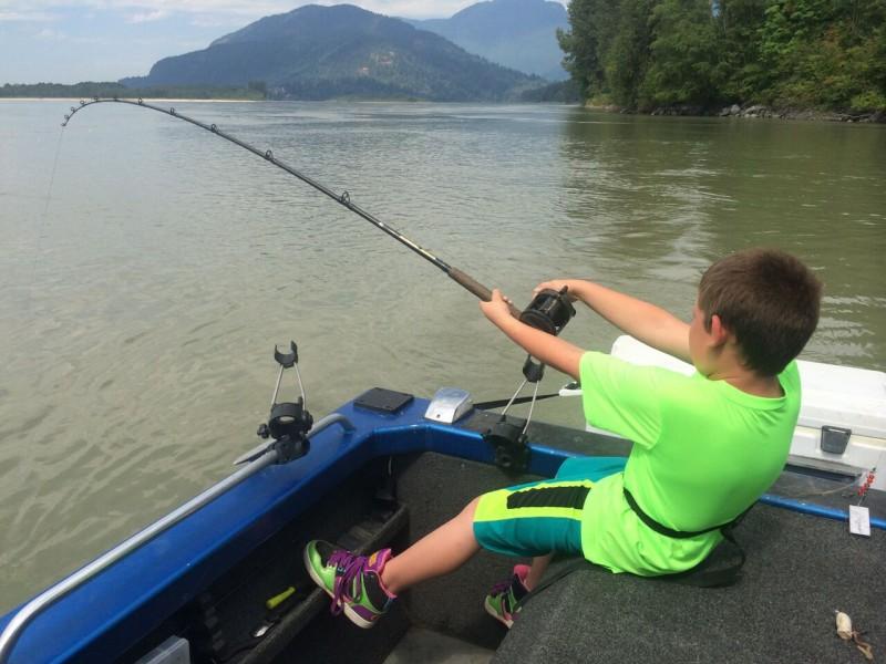 Kegan struggling to reel the behemoth fish in.