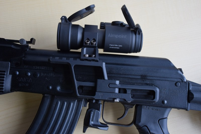 An RS Regulate AK-300 side mount attached to the rifle's side rail holding an Aimpoint PRO.