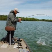 Jon Howard fights a smallmouth bass on an inland lake near Petoskey.