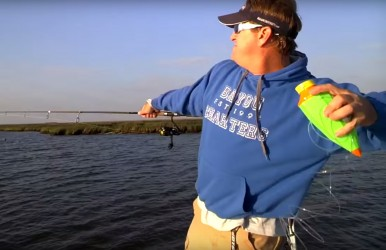 Charter Captain Charlie Thomason trying out a Fish Call. As you can see, it is thrown much like a football.