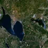 An aerial view of Mountain Meadows Reservoir with Lake Almanor to the left.