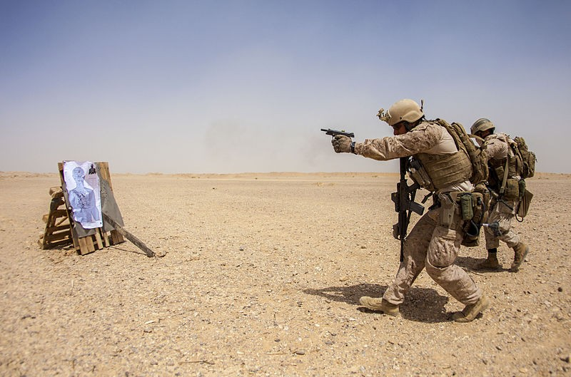 An US Marine fires the M1911 during an exercise in 2013.