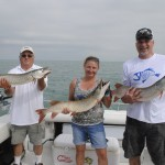 Deny Wilton (left), Becky Dean, and Mark Olschanski show off three muskies taken in rapid succession.